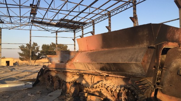 The remains of an ISIS armored vehicle, lies useless after being bombed by the coalition airstrikes.
