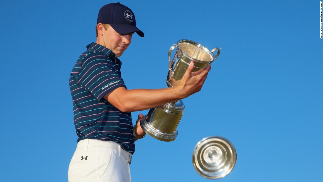 "Jordan Spieth of the United States holds the trophy for the 115th U.S. Open Championship at Chambers Bay on Sunday, June 21, in University Place, Washington.  The <a href=""http://edition.cnn.com/2015/06/21/golf/golf-us-open-spieth/"" target=""_blank"">21-year-old is the youngest U.S. Open champion</a> since Bobby Jones in 1923 and only the sixth man in history to win this title and the Masters in the same year. Tiger Woods won it last, in 2002."
