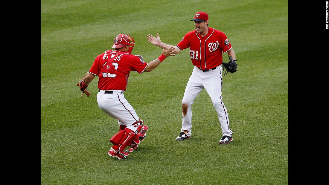 After throwing a no-hitter game on Saturday, June 20, Washington Nationals starting pitcher Max Scherzer celebrates with catcher Wilson Ramos. The Nationals defeated the Pittsburgh Pirates 6-0 at Nationals Park in Washington.
