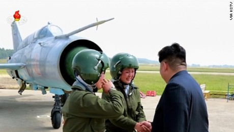 Nortk Korea leader Kim Jong Un greets two female fighter jet pilots