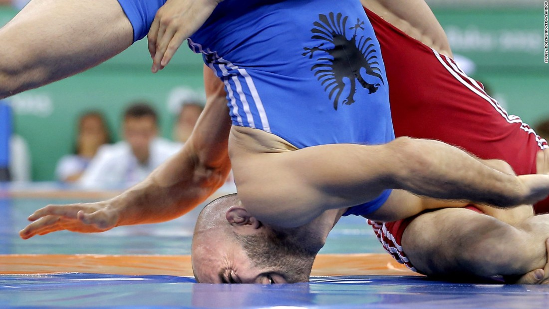 Islam Islamaj of Albania face plants while wrestling Alexandru Chirtoaca of Moldova in the men's freestyle 57-kilogram bronze match wrestling at the Baku 2015 European Games on Wednesday, June 17.