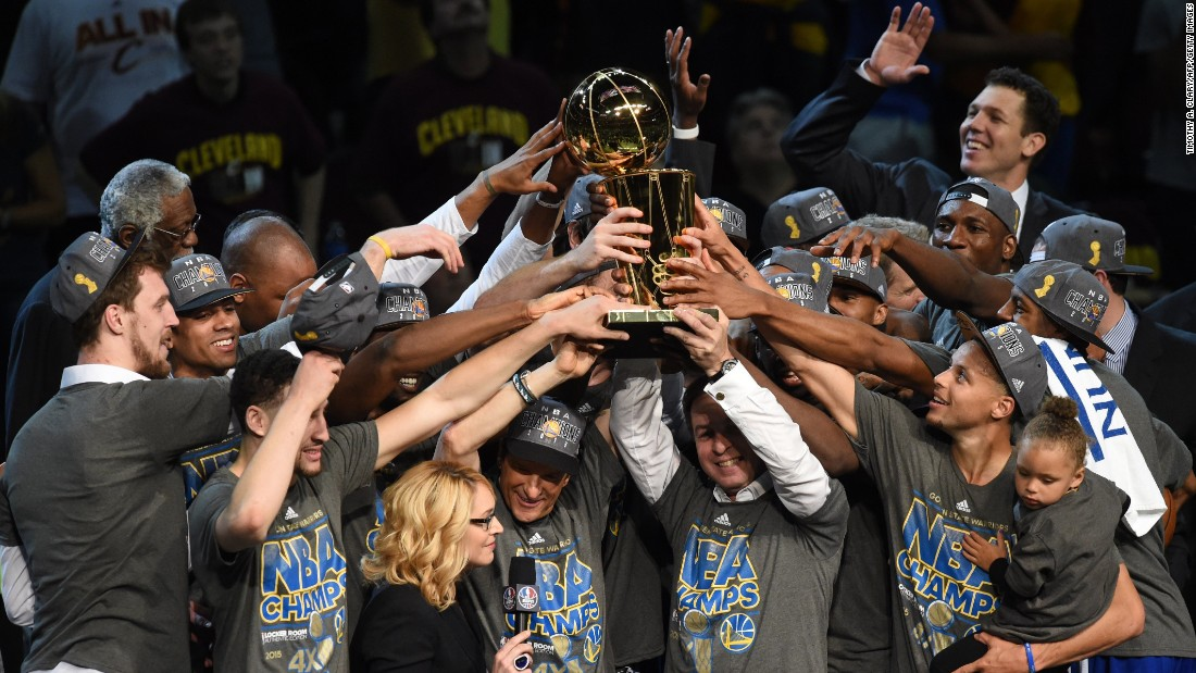 The Golden State Warriors celebrate their first NBA Finals title in 40 years after defeating the Cleveland Cavaliers 105-97 on Tuesday, June 16, in Cleveland.
