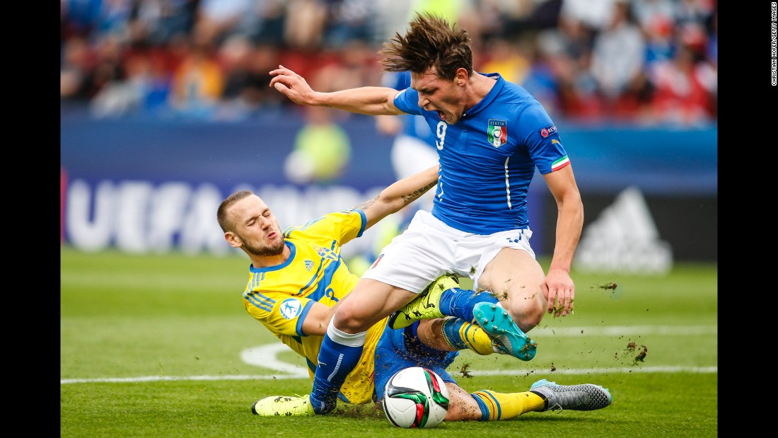 Alexander Milosevic of Sweden, left, tackles Andrea Belotti of Italy during the UEFA Under-21 European Championship on Thursday, June 18, in Olomouc, Czech Republic.