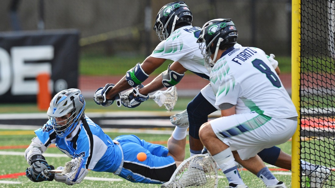 James Dailey of the Ohio Machine lays out to attempt a lacrosse shot as Chesapeake Bayhawks players Tyler Fiorito, No. 8, and Mark McNeill defend the goal on Saturday, June 20, at Selby Stadium in Delaware, Ohio.