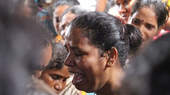 Nearly 100 people have died after drinking toxic alcohol in a slum in Mumbai.