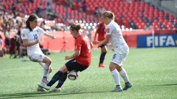 Norway forward Isabell Herlovsen, center, fights for the ball against England