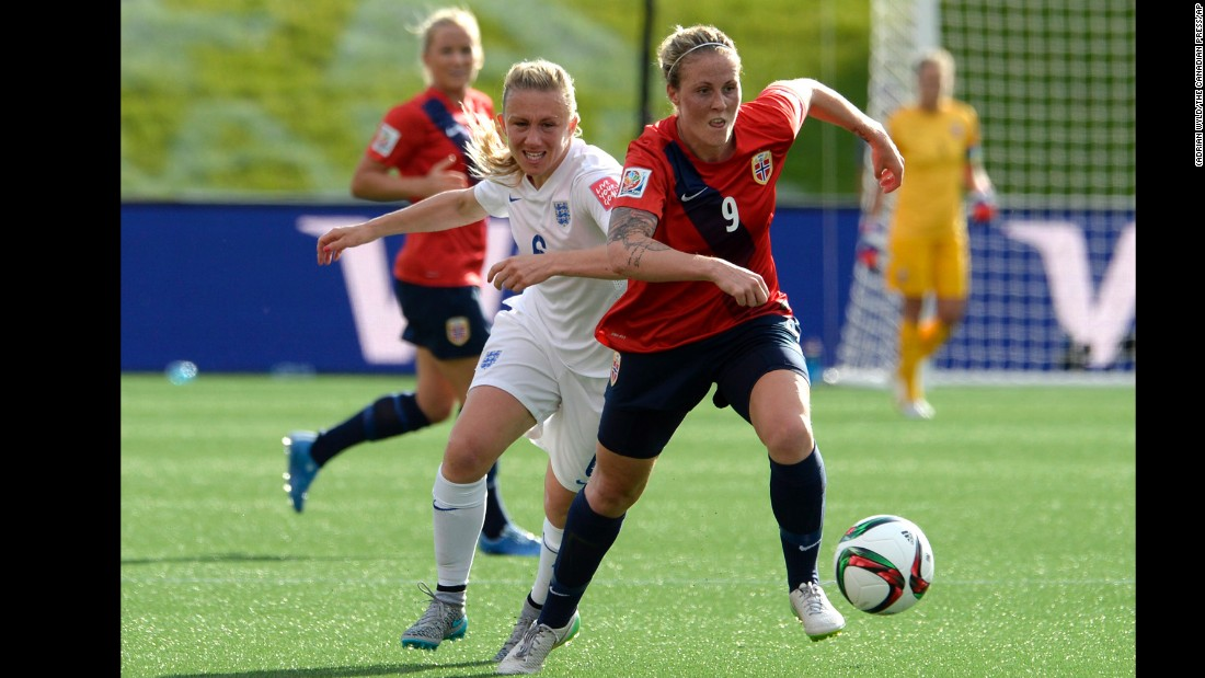 England's Laura Bassett, left, chases Herlovsen in the second half.
