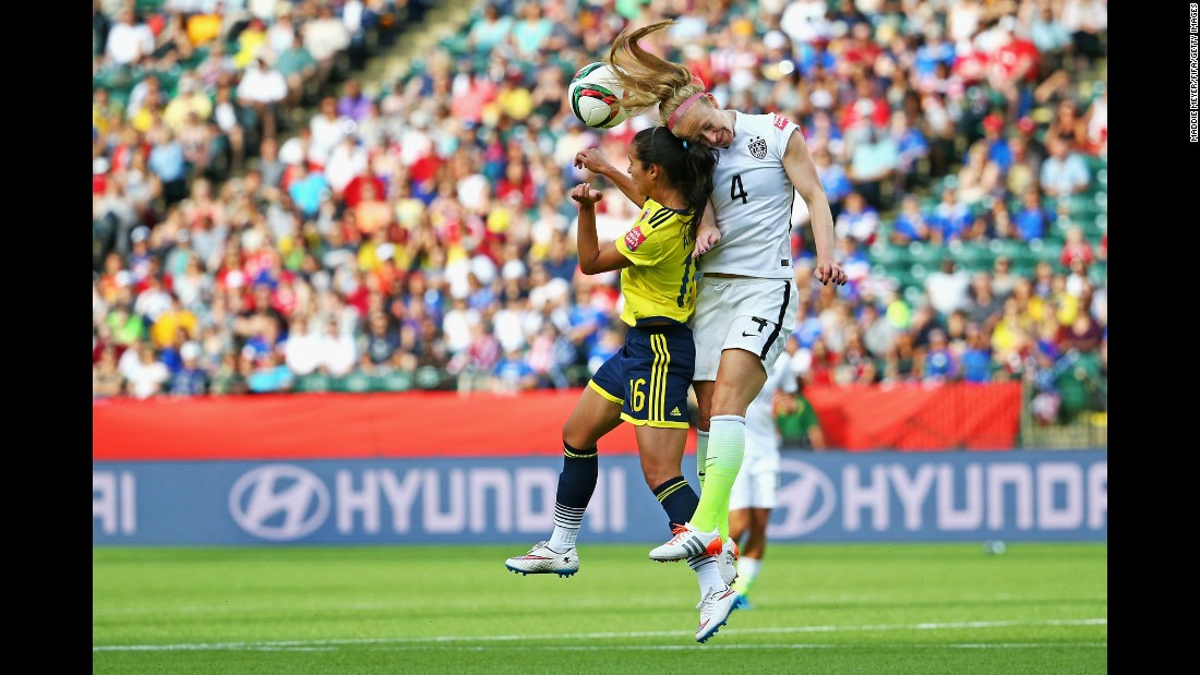 "Becky Sauerbrunn, right, of the United States wins a header over Colombia's Lady Andrade during the FIFA Women's World Cup at Commonwealth Stadium in Edmonton, Canada, on Monday, June 22. The United States won 2-0. <a href=""http://www.cnn.com/2015/06/12/football/gallery/usa-highlights-womens-world-cup/index.html"">See more photos of the U.S. team in the Women's World Cup</a>"