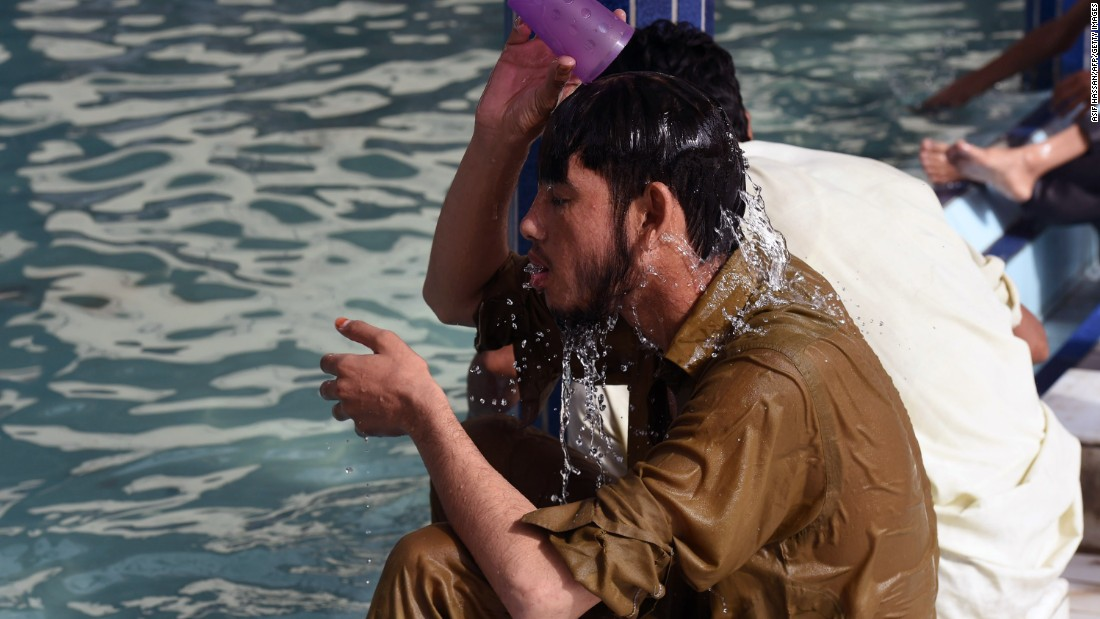A Pakistani man cools down at a mosque during the heat wave in Karachi on June 22.