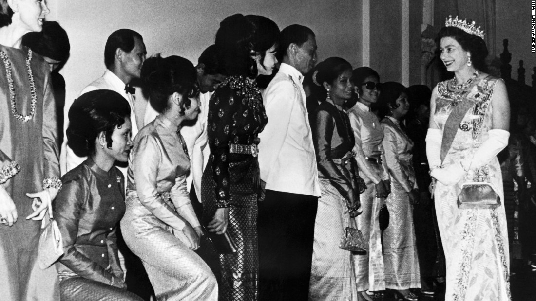 The Queen's first visit to Thailand shows her here visiting the Grand Palace in Bangkok in February 1972.
