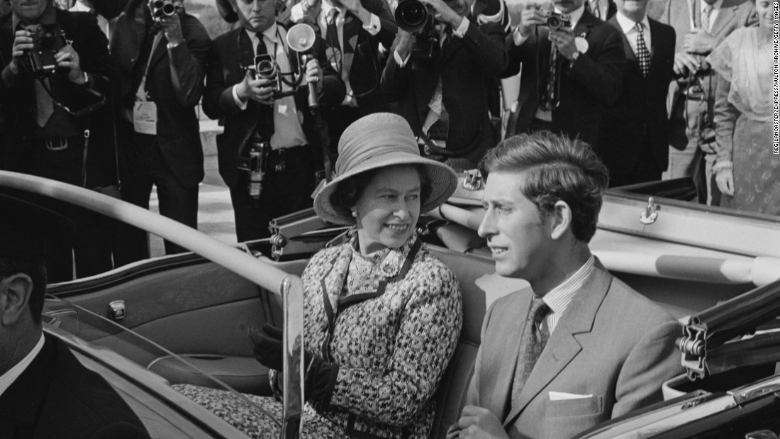 The Queen and Prince Charles seem to be enjoying their open-top car ride during a state visit to Avignon, France, in May 1972, three years after being invested with the title of Prince of Wales.