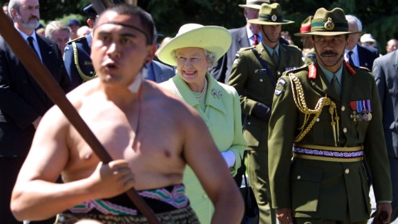 As the Queen visits a military camp in Christchurch, New Zealand, a Maori warrior performs the Haka in February 2002.