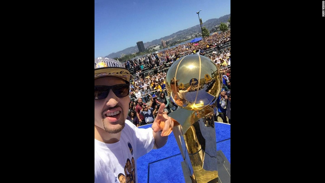 "Basketball star Klay Thompson <a href=""https://twitter.com/KlayThompson/status/611991938619707392"" target=""_blank"">poses with the Larry O'Brien Trophy</a> on Friday, June 19. Thompson and the Golden State Warriors were celebrating with their fans a few days after winning the NBA Finals."