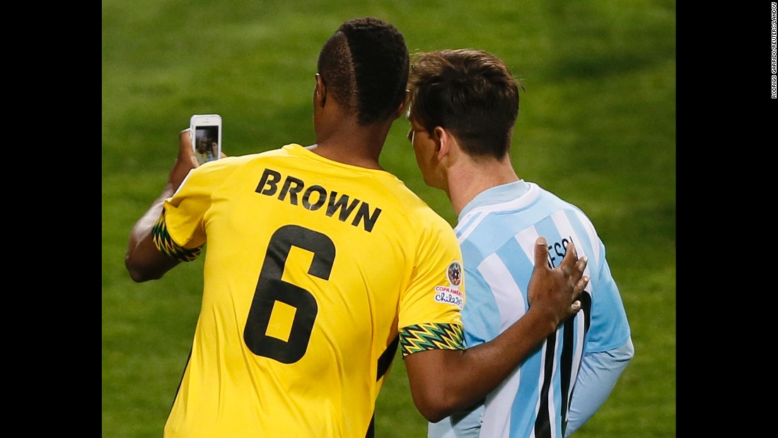 Jamaica's DeShorn Brown snaps an on-field selfie with Argentina's Lionel Messi after a first-round match at the Copa America on Saturday, June 20.