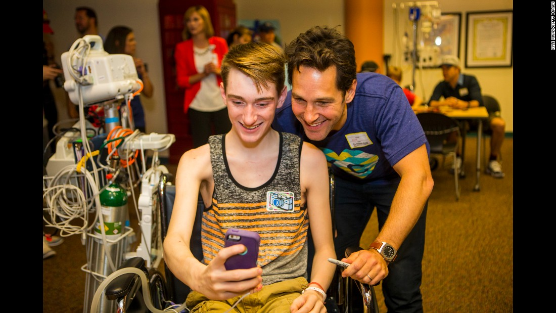 Actor Paul Rudd poses for a fan at a hospital in Kansas City, Missouri, on Friday, June 19.