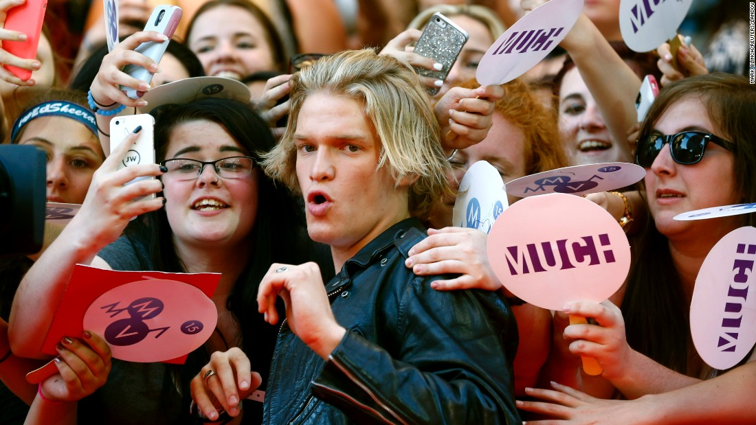 Singer Cody Simpson visits with fans in Toronto after arriving to the Much Music Video Awards on Sunday, June 21.