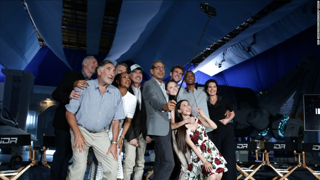 "Actor Jeff Goldblum uses a selfie stick to get a photo with the cast of the upcoming film ""Independence Day Resurgence"" on Monday, June 22. Behind Goldblum, from left, are Brent Spiner, Judd Hirsch, Bill Pullman, Vivica A. Fox, director Roland Emmerich, Maika Monroe, Liam Hemsworth, Grace Huang, Jessie Usher and Sela Ward."