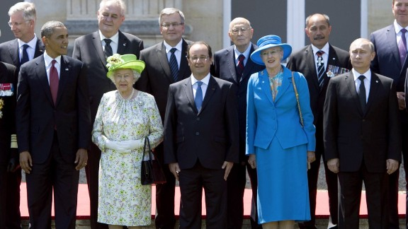The Queen is joined by U.S. President Barack Obama, French President Francois Hollande, Queen Margrethe of Denmark and Russian President Vladimir Putin for a group photo of world leaders attending the D-Day 70th Anniversary ceremonies at Chateau de Benouville in Benouville, France, June 6, 2014.