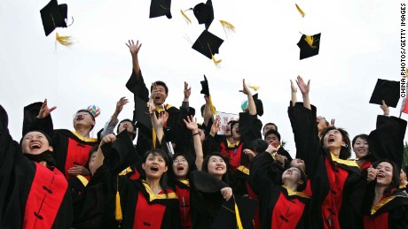 SHANGHAI, CHINA - JUNE 20: (CHINA OUT; PHOTOCOME OUT) Graduates throw their caps during the graduation ceremony at Shanghai Jiaotong University on June 20, 2005 in Shanghai, China. According to the Ministry of Education, about 3.38 million college students will graduate this summer, 580,000 more than last year. Graduates face fierce job competition, as the number of graduates leaving colleges and universities have increased since 1999. (Photo by China Photos/Getty Images)