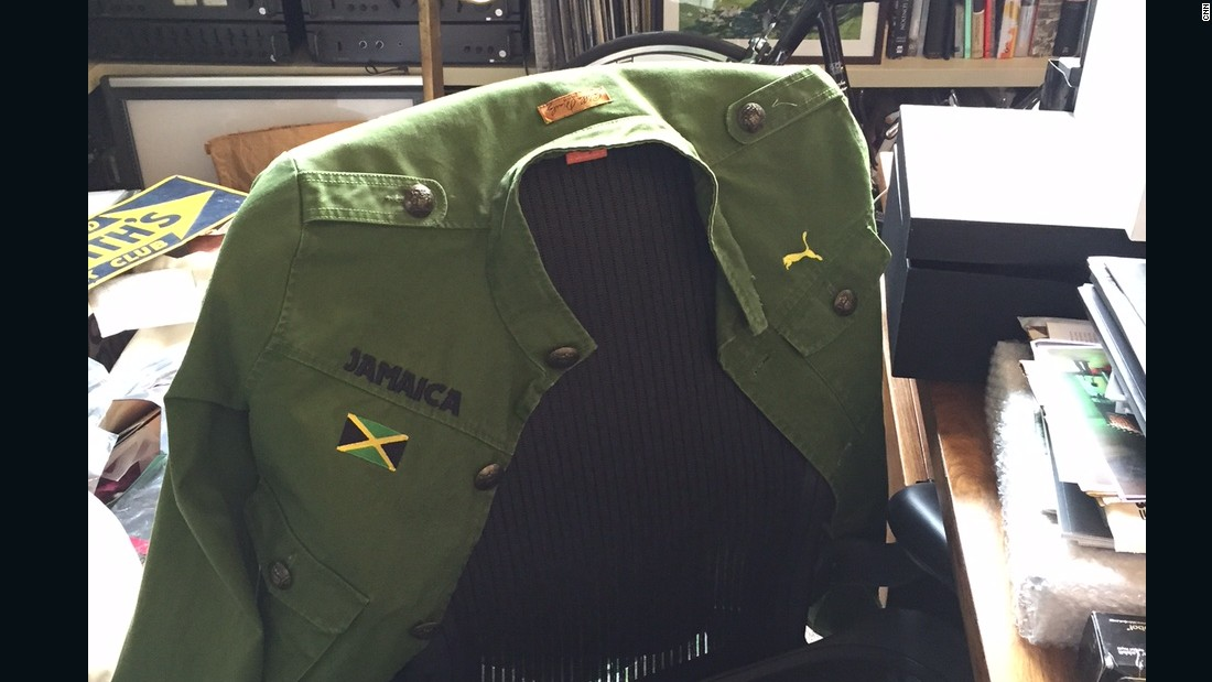 On the back of Smith's desk chair is a jacket that belonged to Usain Bolt.
