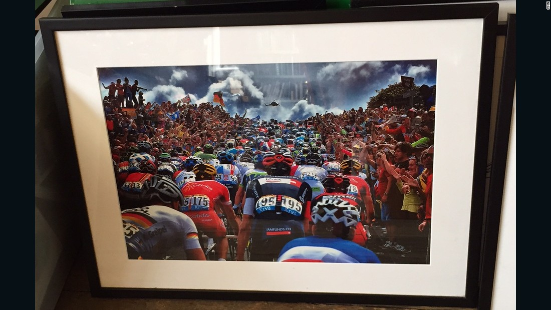 Among the boxes of famed photographs in his office is this one of the opening stage of the 2014 Tour de France, held in Yorkshire, England.