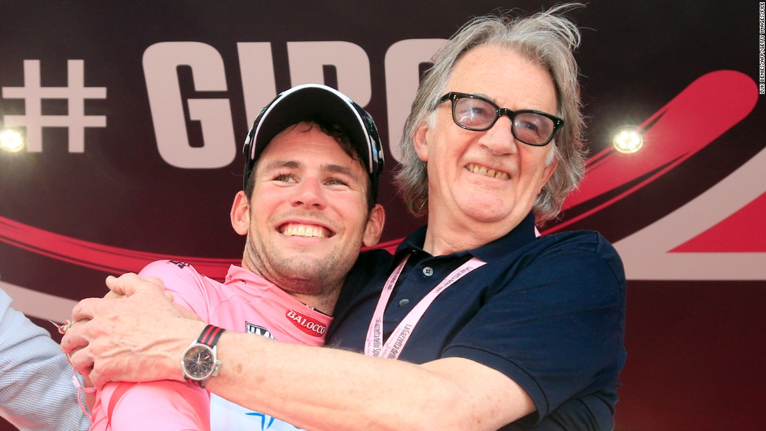 Smith celebrates with Cavendish after his win in the opening stage of the 2013 Giro d'Italia. The pink jerseys for the race were designed by Smith.