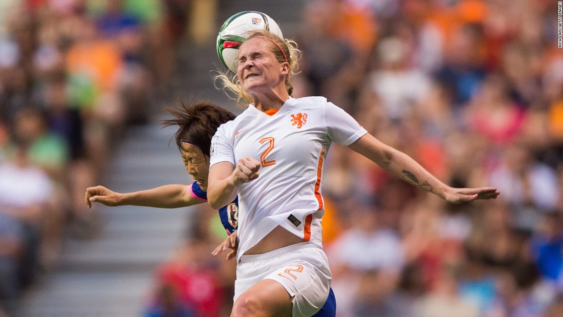 Dutch player Desiree van Lunteren heads the ball during the match against Japan.