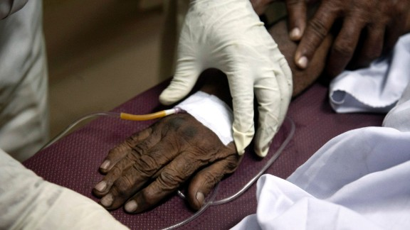 A patient suffering from heatstroke receives treatment at a Karachi  hospital on Wednesday, June 24.