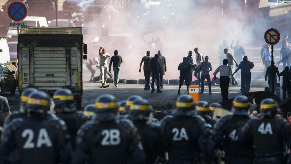 """French taxi drivers clash with riot police while disrupting Paris rush-hour during a<a href=""""http://www.cnn.com/2015/06/25/europe/france-paris-uberpop-protests/""""> protest against online ride service UberPOP</a> on Thursday, June 25. The cabbies say Uber threatens their jobs by taking customers away from licensed cab companies. The French goverment ruled the UberPOP app illegal last year, but the company hasn't exhausted all legal recourse."""