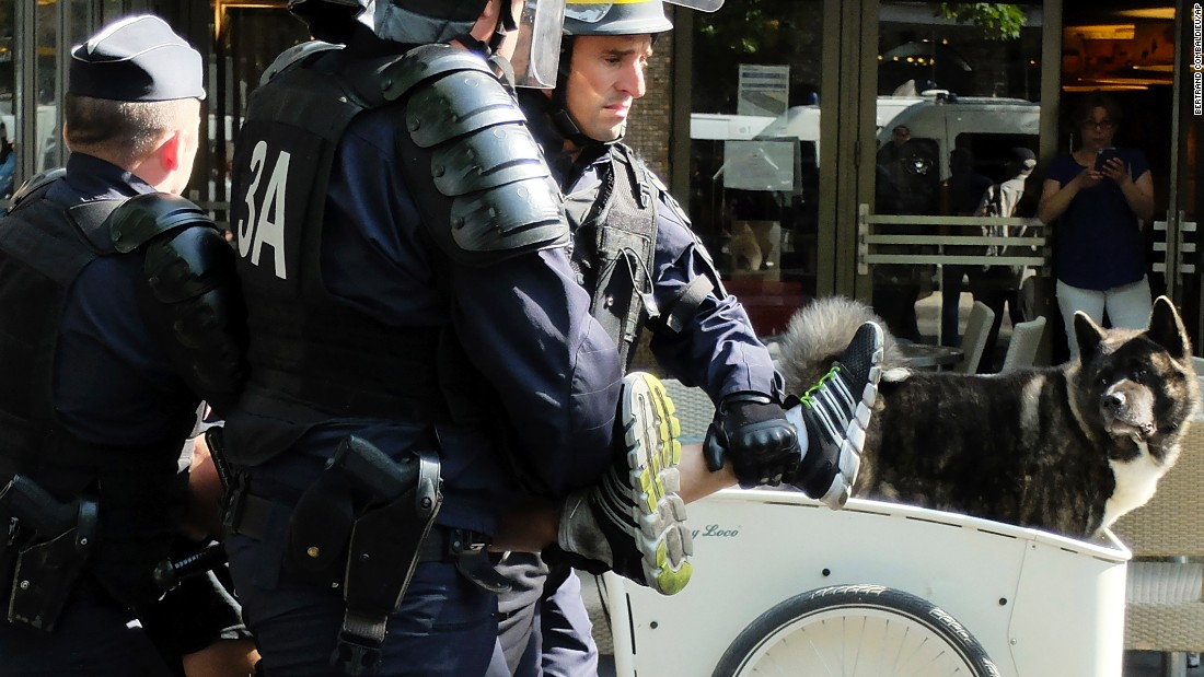 Police detain a protester in Paris on June 25.
