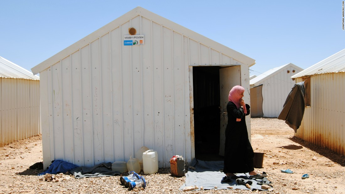 Sharouk, 15, lives in this metal box with her mother (pictured) and her two younger siblings.