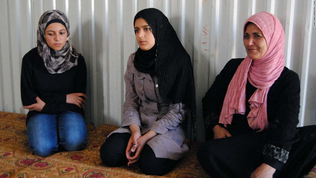 The family's father stayed behind in Syria, and Sharouk's mother (R) says they can only afford to call him once a month.