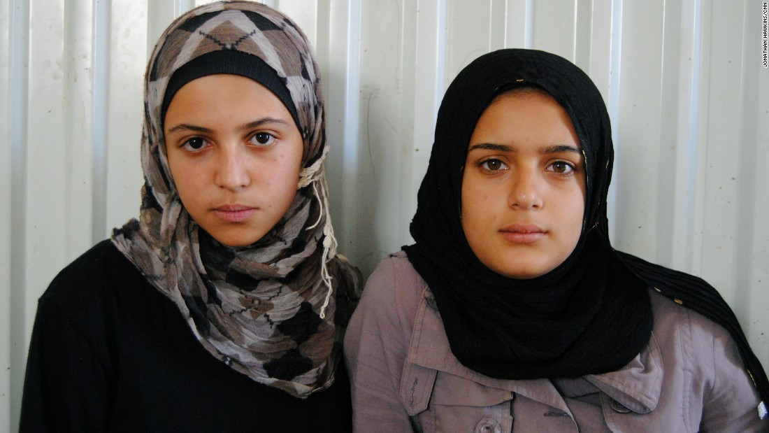 Sharouk (R) hasn't gone to school in a year. But after speaking to Mazoun, Sharouk says she will be in class in September.