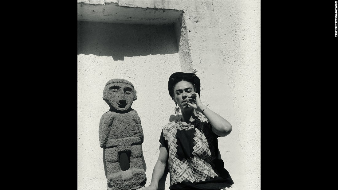 Kahlo smokes in her garden in 1951. The German-born Freund was an accomplished documentary photographer and became famous for her portraits of writers and artists like Kahlo.