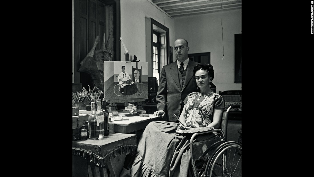 Kahlo and Dr. Juan Farill are photographed in her home in 1951. In 1950, Kahlo underwent several surgeries for reoccurring spinal issues, and she had to use a wheelchair.