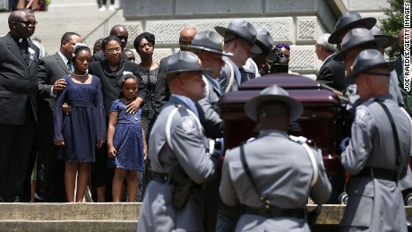 As lawmakers, family and friends look on, the South Carolina Highway Patrol Honor Guard carry the coffin of church pastor and South Carolina State Sen. Clementa Pinckney to lie in repose at the Statehouse Rotunda on Wednesday, June 24, 2015 in Columbia.