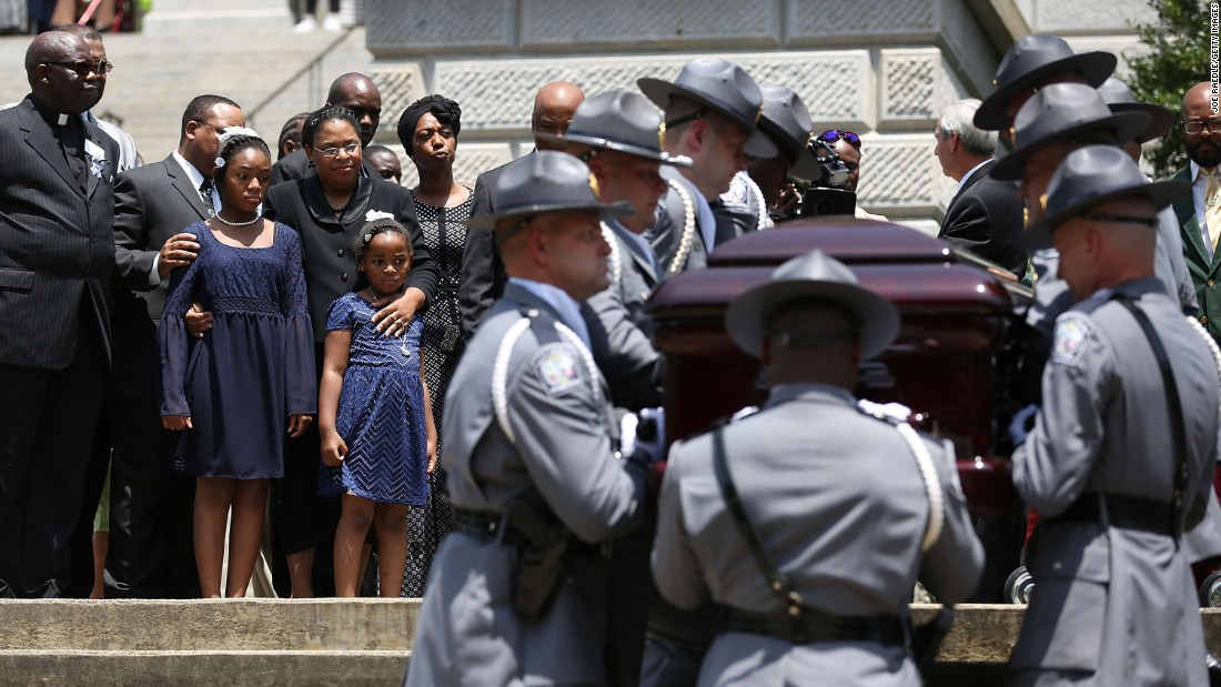 Pinckney's casket is carried to the South Carolina State House in Columbia, South Carolina, on Wednesday, June 24.
