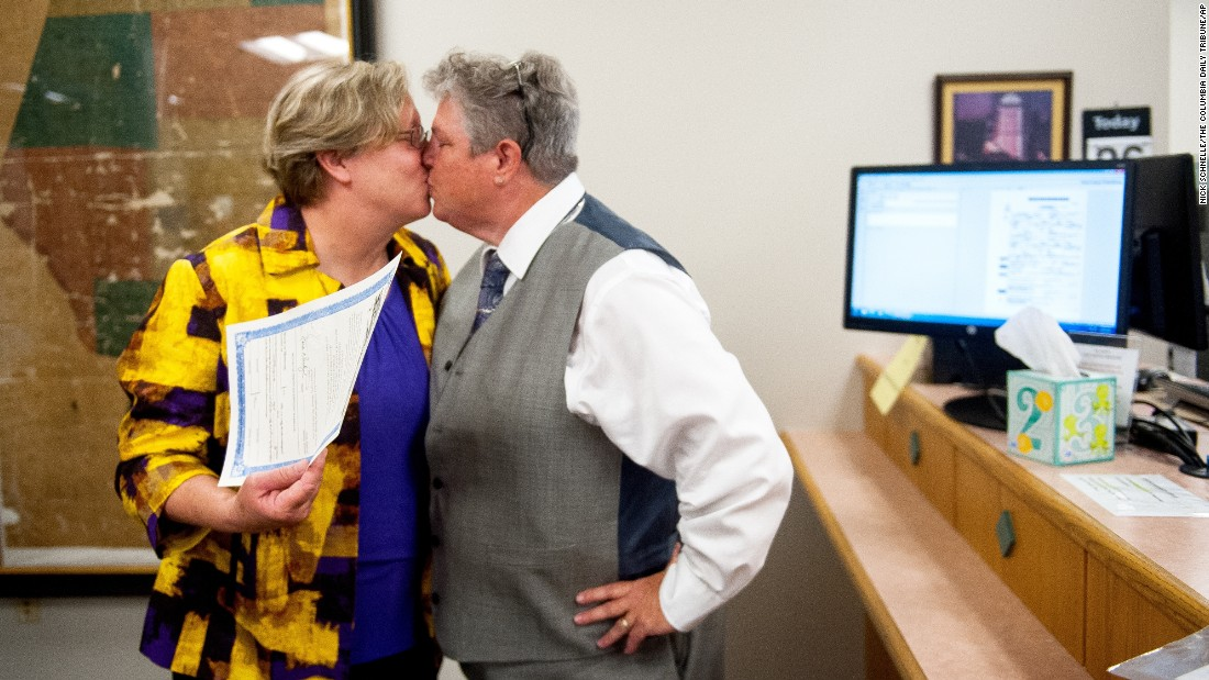 Laura Zinszer, left, and Angela Boyle kiss after receiving their marriage license June 26 in Columbia, Missouri. They were Boone County's first same-sex couple to receive their marriage license.
