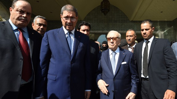 Tunisian President Beji Caid Essebsi, third from right, arrives at the resort with Prime Minister Habib Essid, third from left, and Interior Minister Mohamed Najem Gharsalli, far left.