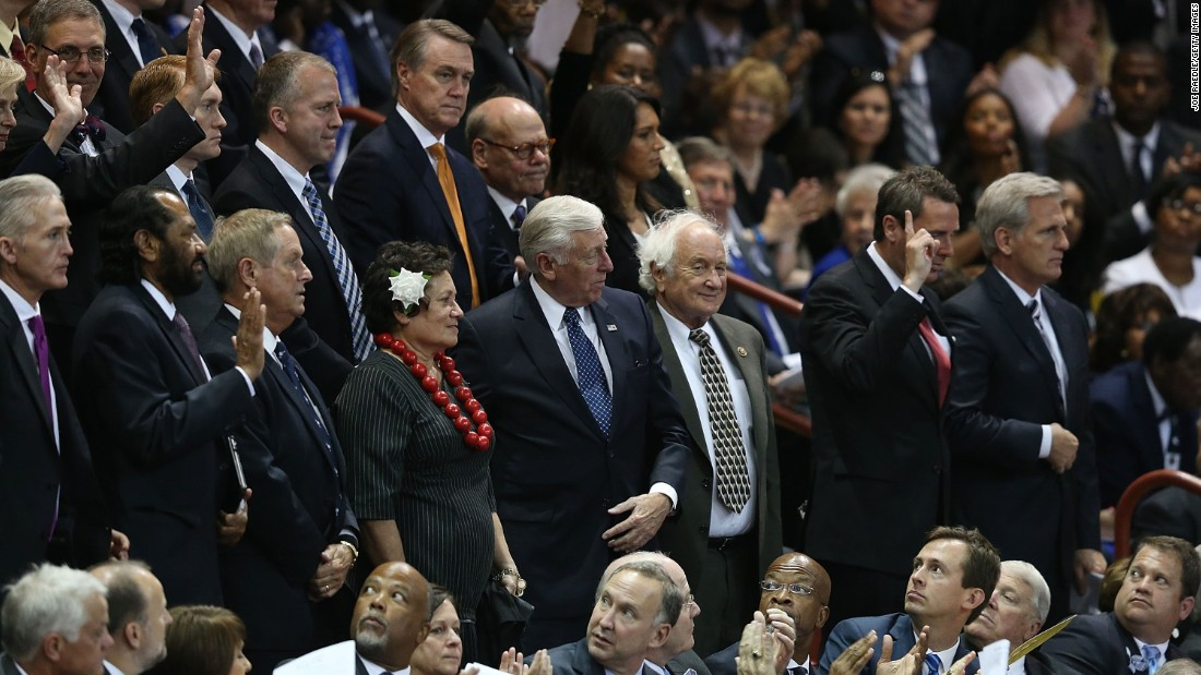 Members of Congress stand as they are introduced at the funeral service, which was held at the TD Arena in Charleston.
