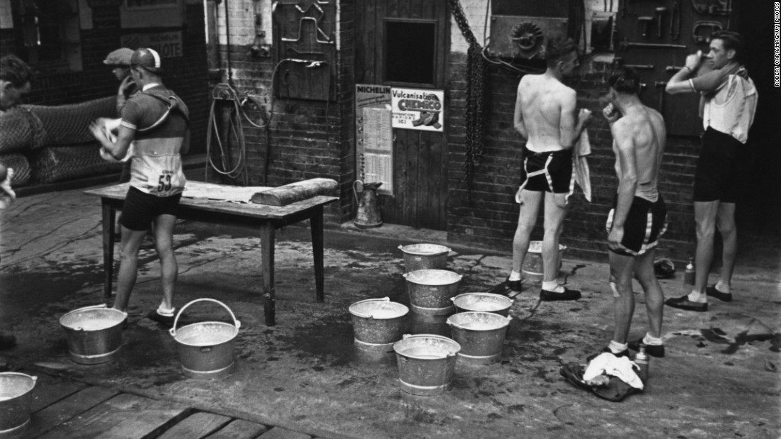 "Nowadays, cyclists are on teams funded by major corporate sponsors, with doctors, dietitians and other specialists on staff catering to their every need. The situation was a little more austere in the '30s. Here, the cyclists stop for the day to rest, wash and clean up. Capa, too, was down to earth; a friend, editor John Morris, <a href=""http://www.ft.com/cms/s/2/3d37a03e-c8be-11e2-acc6-00144feab7de.html#slide0"" target=""_blank"">told FT Magazine that he simply called himself ""a journalist.""</a>"