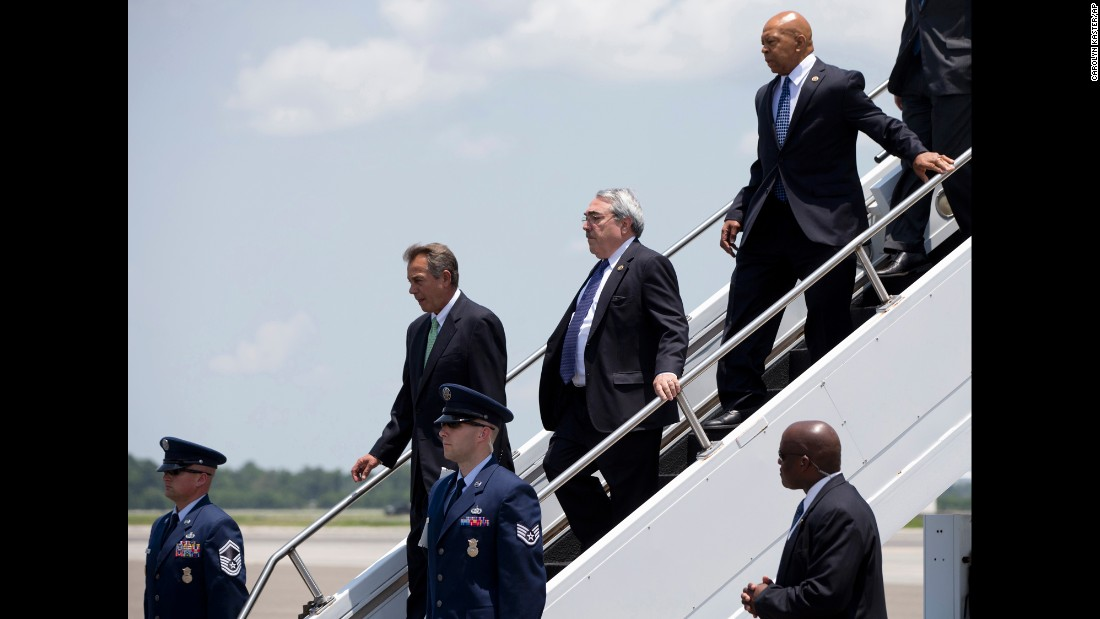 Members of Congress get off Air Force One in Charleston as they accompanied Obama to the service.