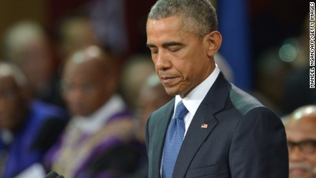 Obama eulogizes pastor killed in church shooting