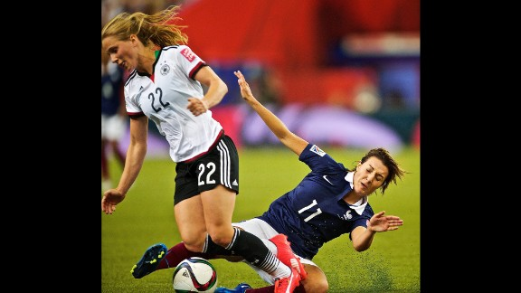 French midfielder Claire Lavogez slides in on  German midfielder Tabea Kemme.