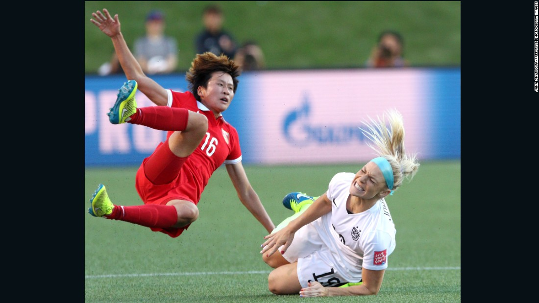 China's Lou Jiahui collides with U.S. defender Julie Johnston.
