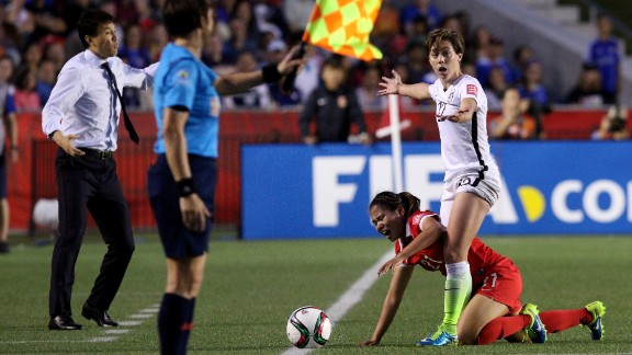 U.S. defender Meghan Klingenberg stands over China's Wang Lisi during a match in Ottawa on Friday, June 26. The United States won 1-0 to advance to the semifinals.