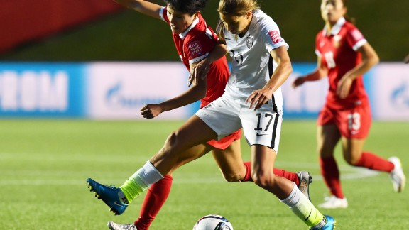 U.S. midfielder Tobin Heath fights for the ball with China