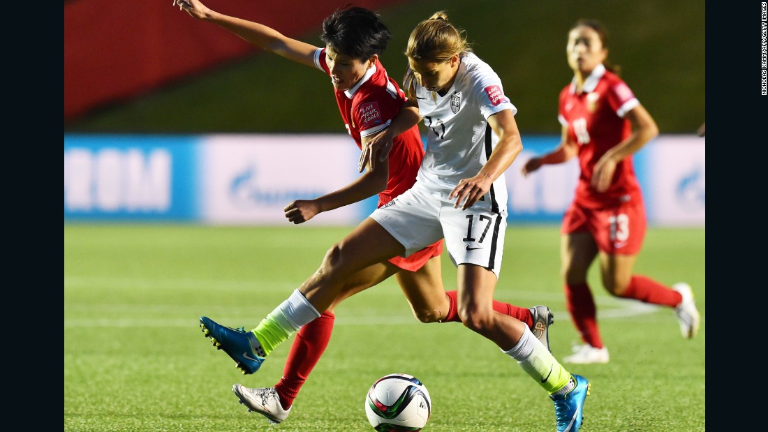 U.S. midfielder Tobin Heath fights for the ball with China's Pang Fengyue.