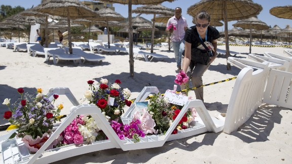 People lay flowers on the beach in front of Hotel Riu Imperial Marhaba, in the coastal city of Sousse, Tunisia, on Saturday, June 27. Gunmen killed at least 38 people at site, the same day terrorists lashed out brutally in France and bombed a mosque in Kuwait.