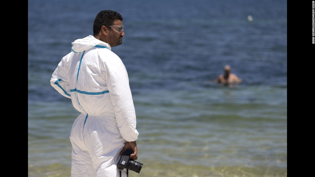 A Tunisian forensics expert inspects the beach on June 27.